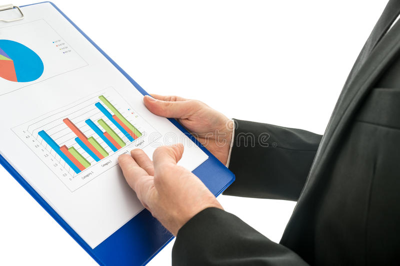 Side view of a businessman analysing a set of graphs over white royalty free stock image