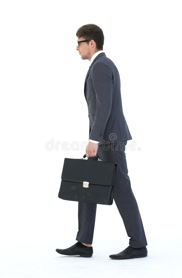 Side view. a businessman with a leather briefcase comes forward. stock photography