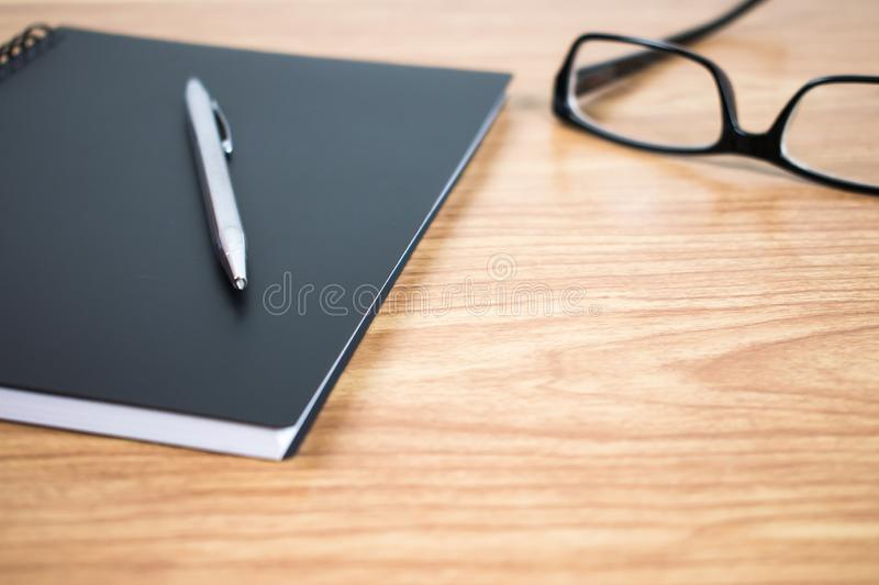 Side view of a pen and notebook at the ready on the table. Close up. royalty free stock image