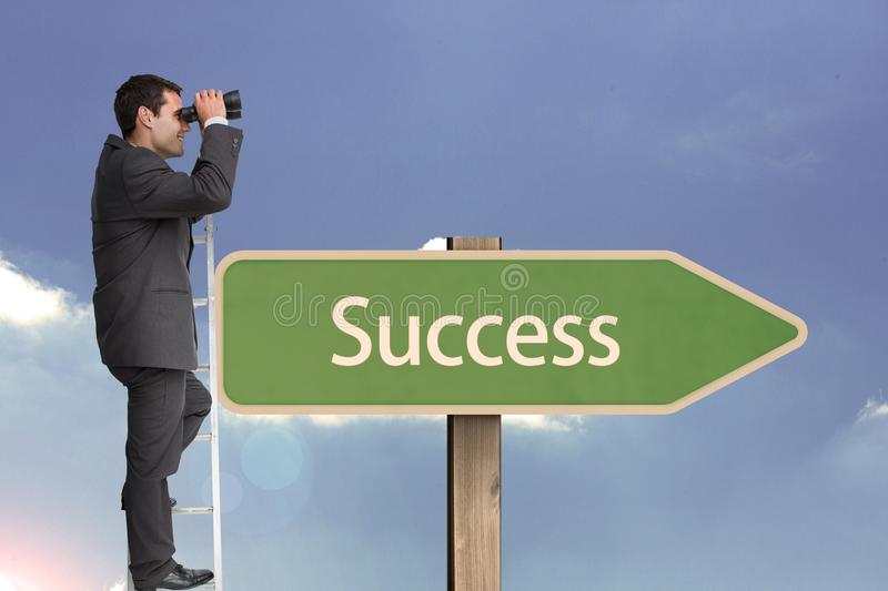 Side view of businessman using binoculars while standing on ladder by succees text on sign board aga royalty free stock photo
