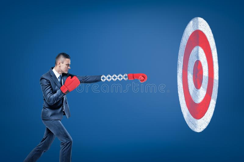 Side view of businessman wearing red boxing gloves and holding out one hand towards big round target. Achieve goals. Determined to succeed. Build competitive royalty free illustration