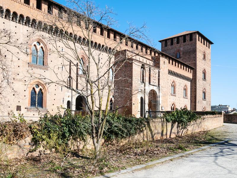 Side view of Castello Visconteo in Pavia city. Travel to Italy - side view of Castello Visconteo (Visconti Castle) in Pavia city in spring stock photo
