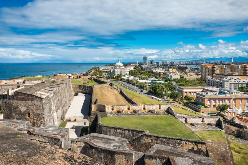 Side view from Castillo de San Cristobal toward town. With ancient walls and grassy fields surrounding the castle royalty free stock photo