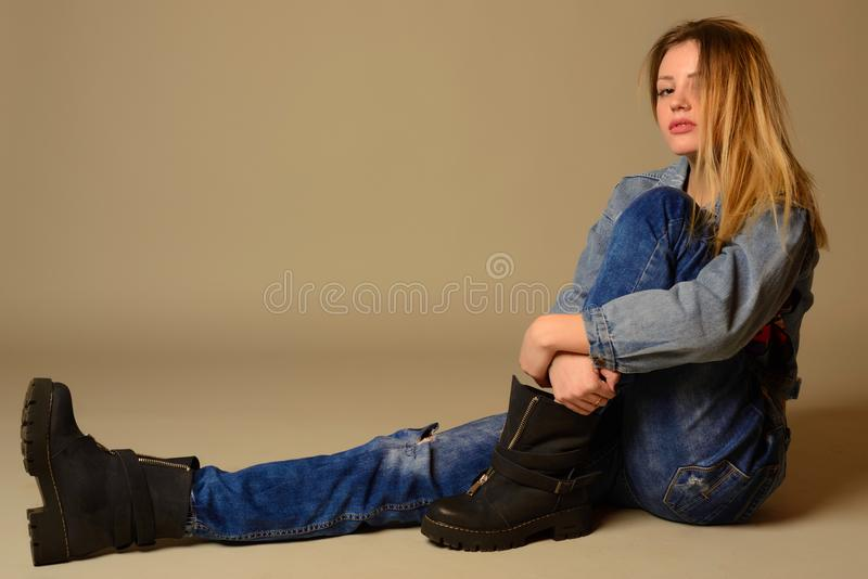 Side view of a casual young woman laying on the floor stock images