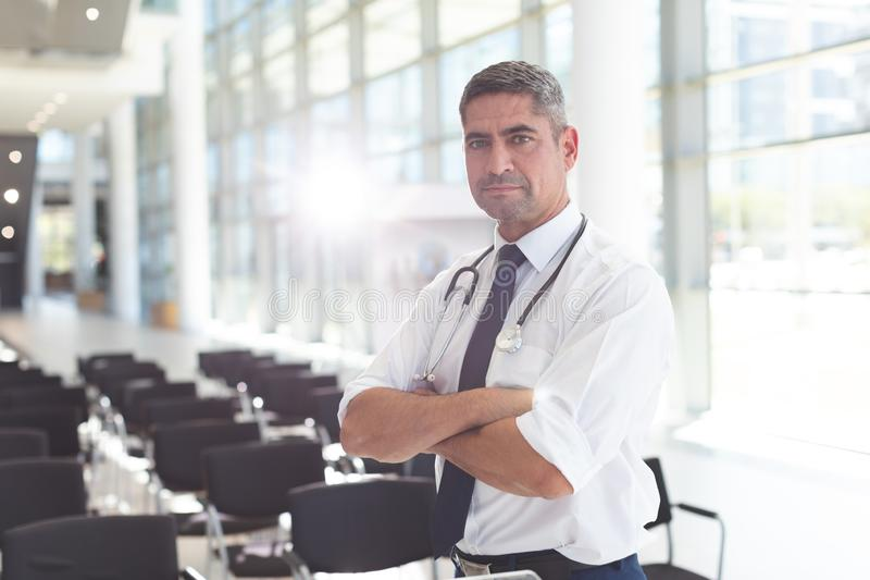 Male doctor with arms crossed looking at camera stock photos