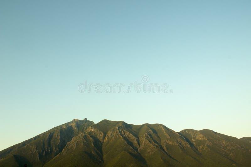 Side view of the Cerro de la Silla Mountain. Side view of the Cerro de la Silla Mountain, in Monterrey, Nuevo Leon, Mexico. It`s the most famous natural royalty free stock photography