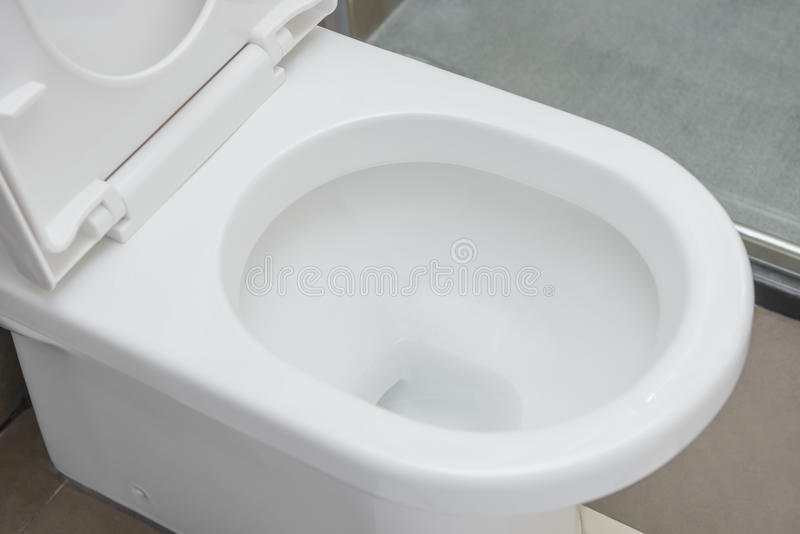 Side view closestool. In bathroom stock image