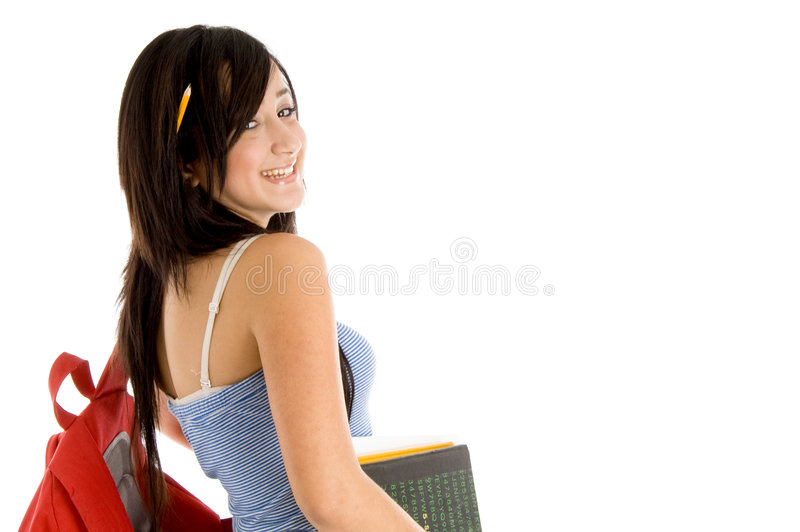 Side view of college girl with bag and books royalty free stock photography