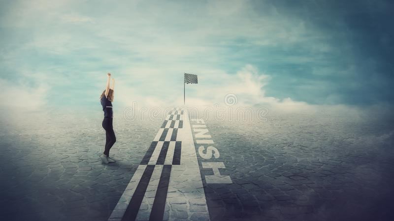 Side view of competitive girl confident crossing the finish line raising hands up celebrating as a winner. Challenge winning. Concept, motivation and success stock images