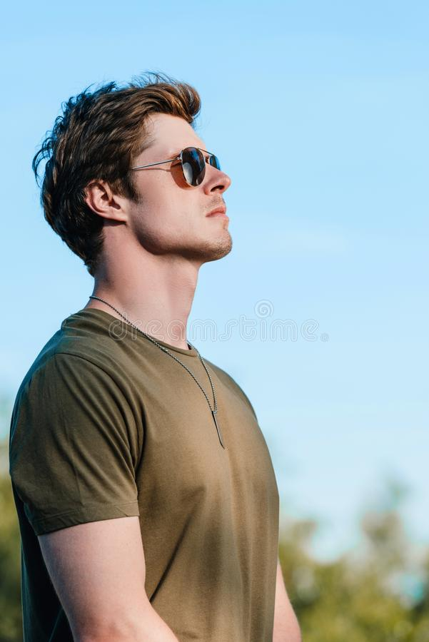 side view of confident soldier in sunglasses against royalty free stock photo