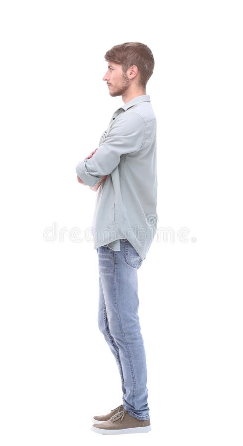 Side view. confident young man in jeans royalty free stock image