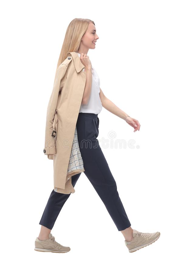 Side view. a confident young woman steps forward. stock photography