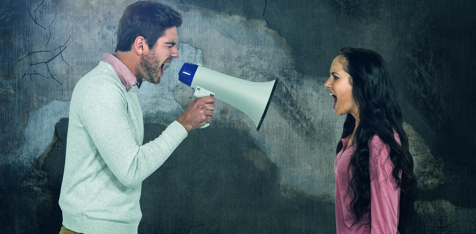 Composite image of side view of couple shouting stock image