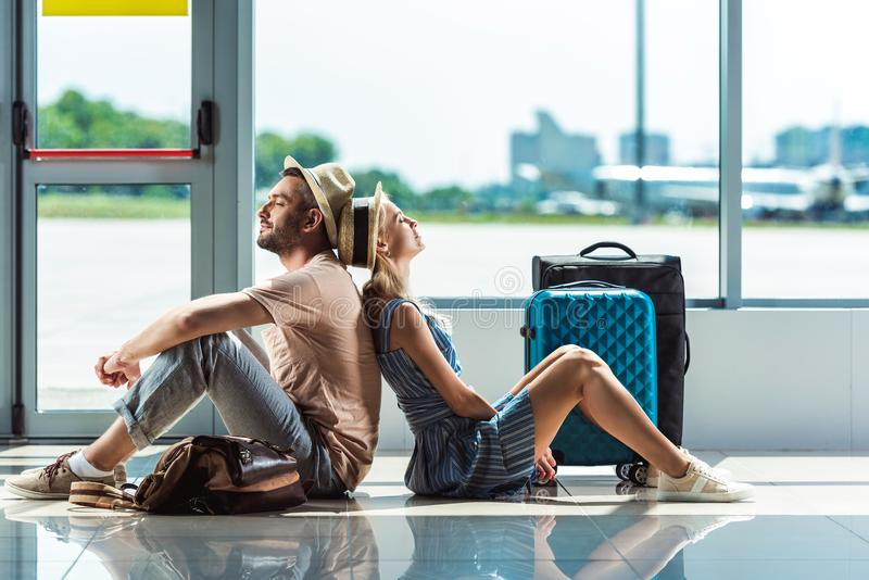 Couple waiting for boarding in airport stock image