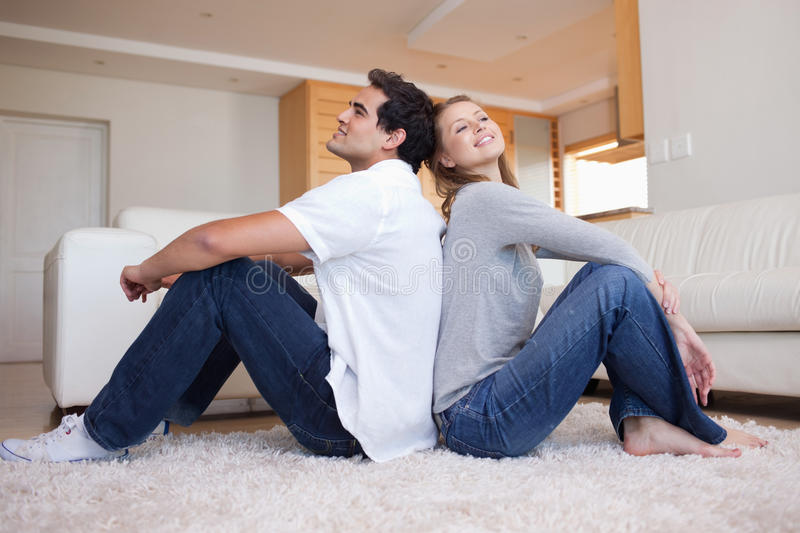 Download Side View Of Couple Sitting On The Floor Stock Images - Image: 22221084