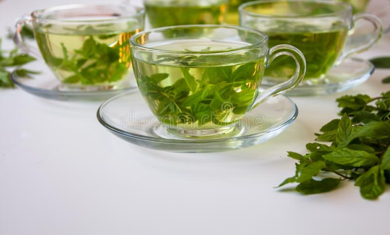 Side view of a Cup of healthy organic fresh herbs tea stock photo