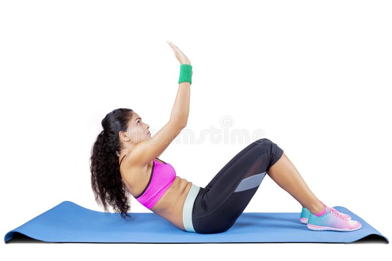 Curly hair woman doing crunches exercises royalty free stock images