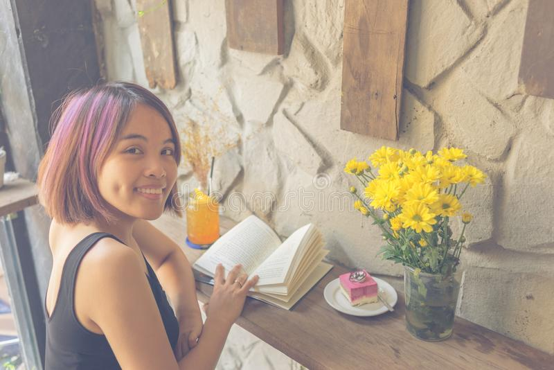 Cute Asian girl reading book royalty free stock photography