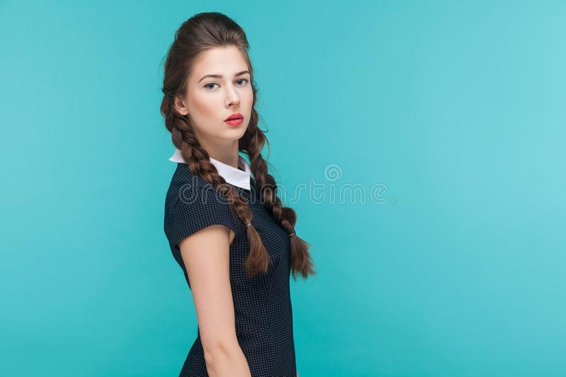 Side view cute seduction woman with pigtails. Love , flirt concept. Studio shot royalty free stock photography