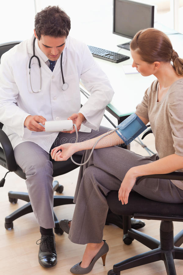 Download Side View Of Doctor Taking His Patients Blood Pressure Stock Image - Image: 22221685