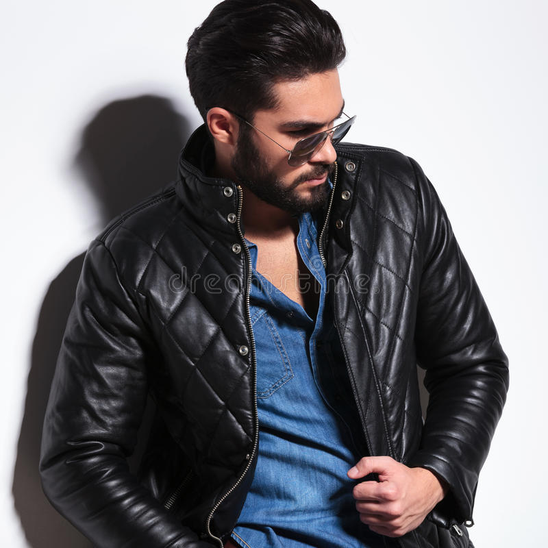 Side view of a dramatic fashion male model posing stock photography
