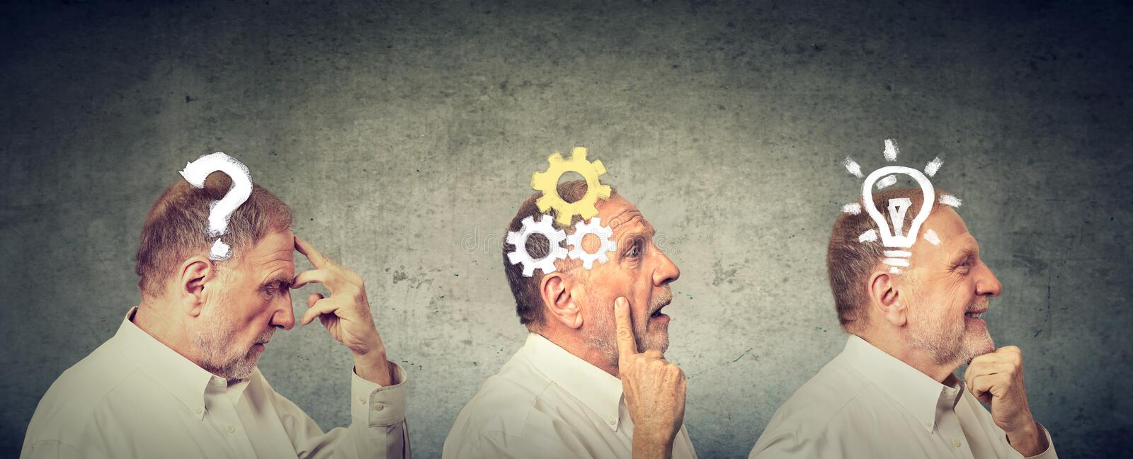 Side view of an elderly man thoughtful, thinking, finding solution with gear mechanism, question, lightbulb stock photos