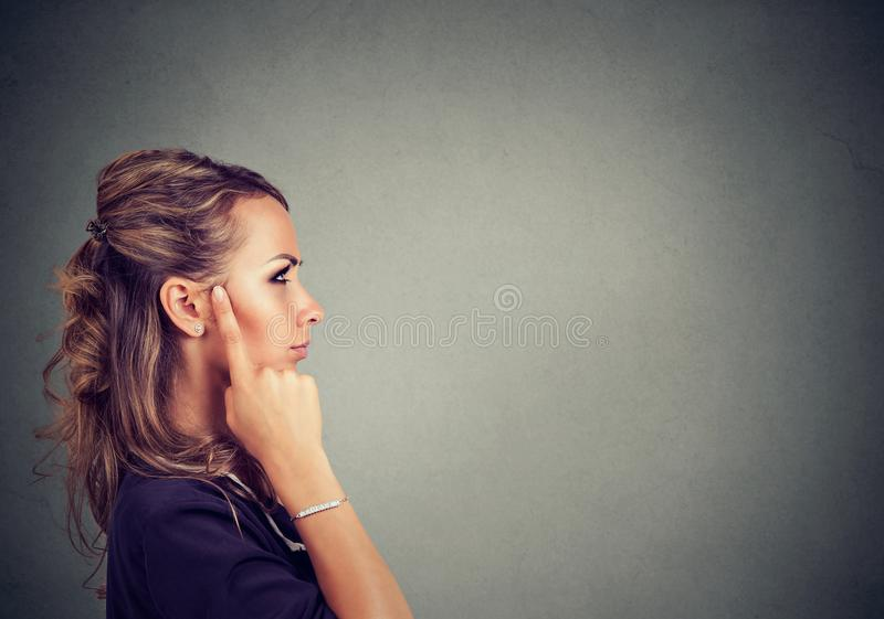 Pensive woman looking for solution royalty free stock photo