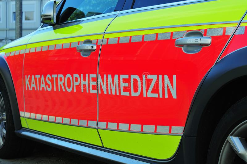 German inscription disaster medicine at emergency car. Side view of an emergency car with inscription disaster medicine in german language stock photo