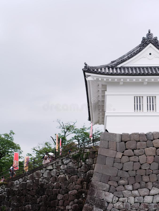 Side view of the entrance of the Odawara Castle, tourists climbing stairs royalty free stock images