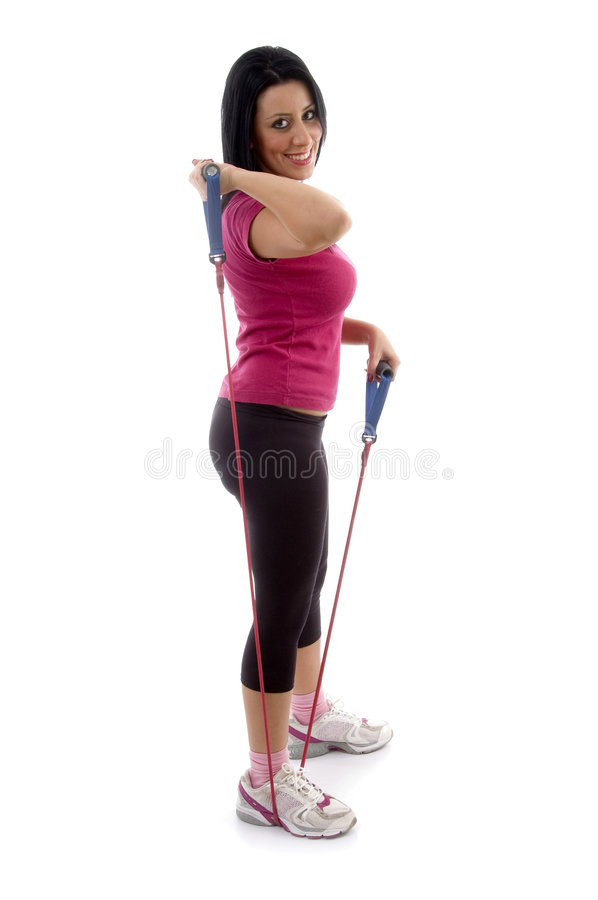 Download Side View Of Exercising Female Looking At Camera Stock Image - Image: 7365065