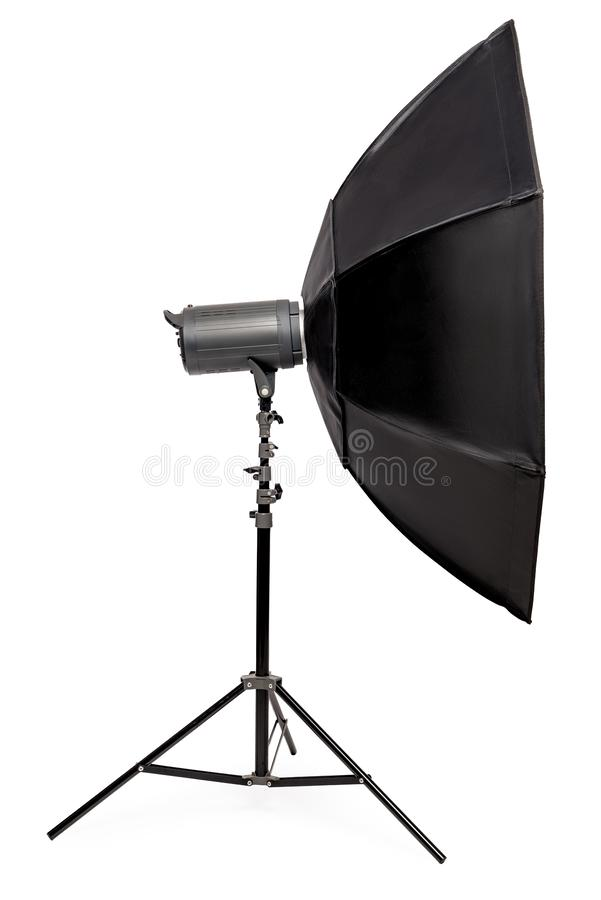 Side view flash with octagonal softbox on stand, studio equipment close-up on a white. Background royalty free stock images