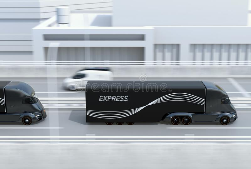 Side view of a fleet of black self-driving electric semi trucks driving on highway stock photo