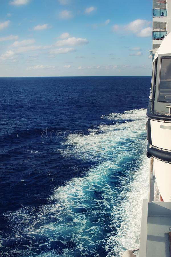 Free Side View From Balcony Deck Of Big Cruise Ship Sailing Ocean Or Sea And Leaving Water Swirl And Churn Trails With Blue Sky On Royalty Free Stock Images - 160545229