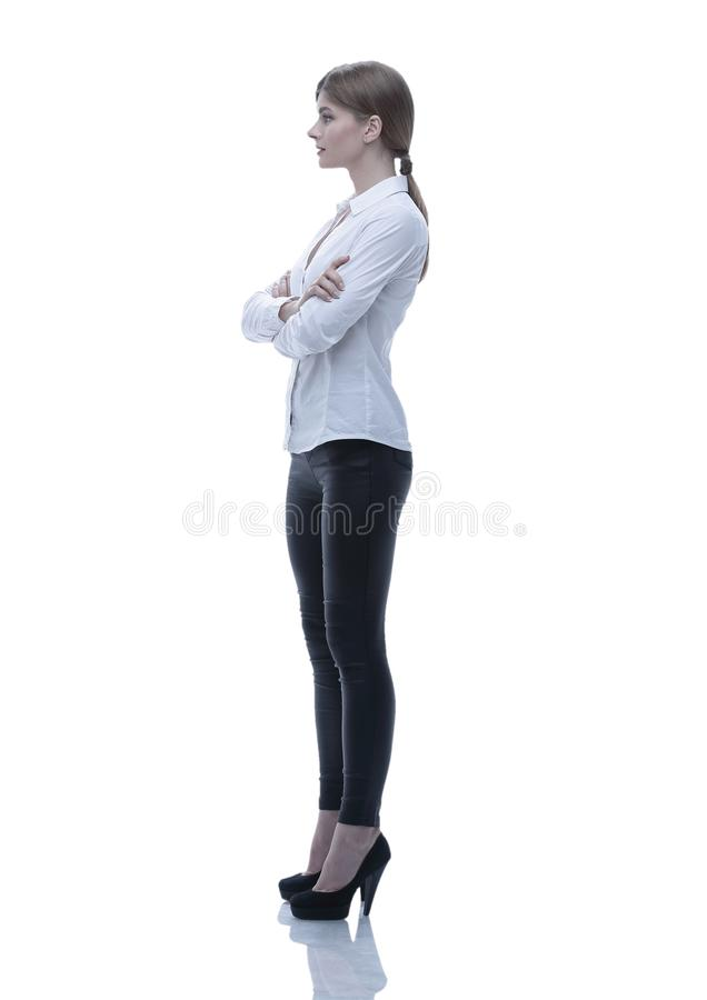 Side view. in full growth.portrait of a confident young woman stock images
