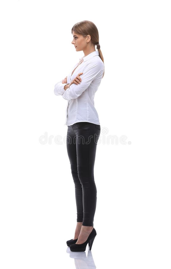 Side view. in full growth.portrait of a confident young woman stock image