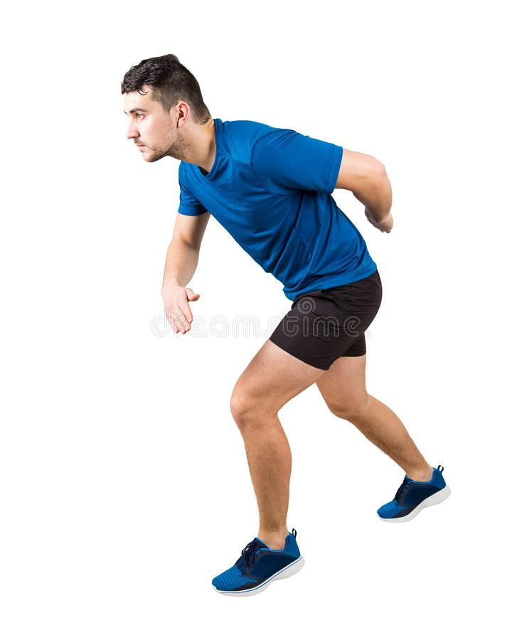 Side view full length of determined caucasian man runner standing in running position looking ahead confident. Young guy sprinter stock photo