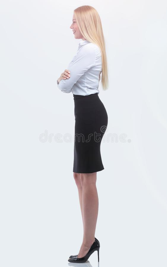 Side view.full-length portrait of a responsible business woman. royalty free stock images