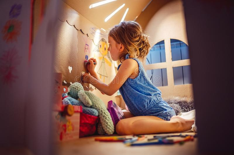 Charming girl playing in toy house stock images