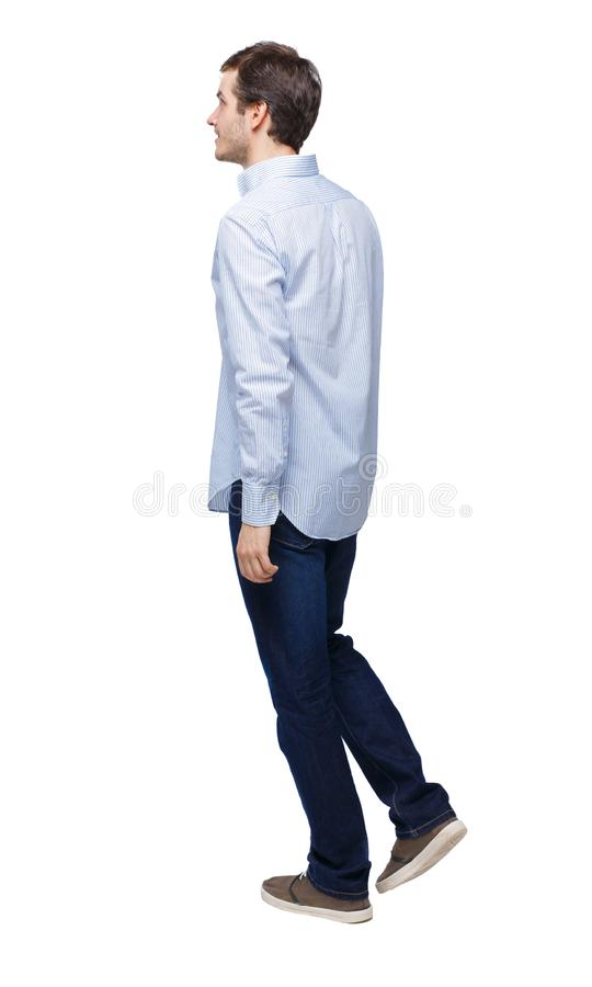 Side view of going handsome man royalty free stock photo