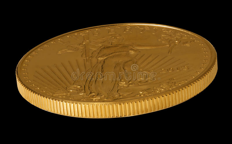 Side view of Gold Eagle one ounce coin royalty free stock images