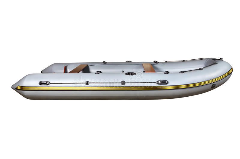 Side view on the gray inflatable rubber boat Dinghy PVC. Side view of one large gray, six-seater, rowing motor, rubber inflatable dinghy boat made of PVC, with stock photos