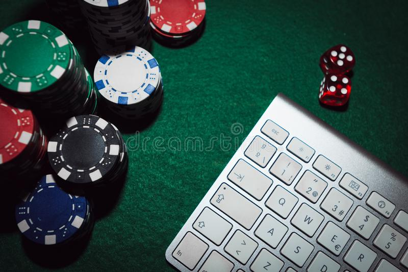 Side View Of A Green Poker Table With Some Poker Cards On A