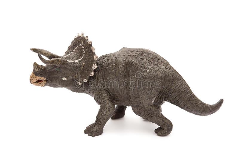 Side view grey triceratops toy on white. Side view grey triceratops toy on a white background royalty free stock images