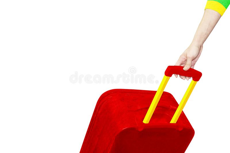 Side view of a hand with a red suitcase, isolated on a white background. place for text, Traveler`s elements stock photo