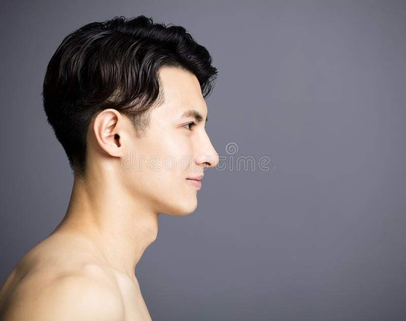Side view of Handsome young men face stock photography