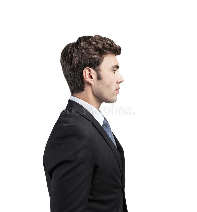 Side view of handsome young businessman, isolated royalty free stock photo