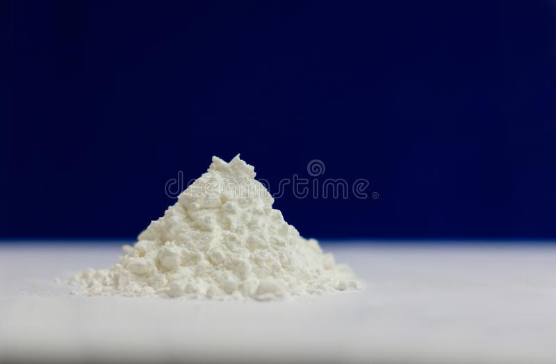 Side view of heap of white modified starch isolated on blue and gray background stock photography