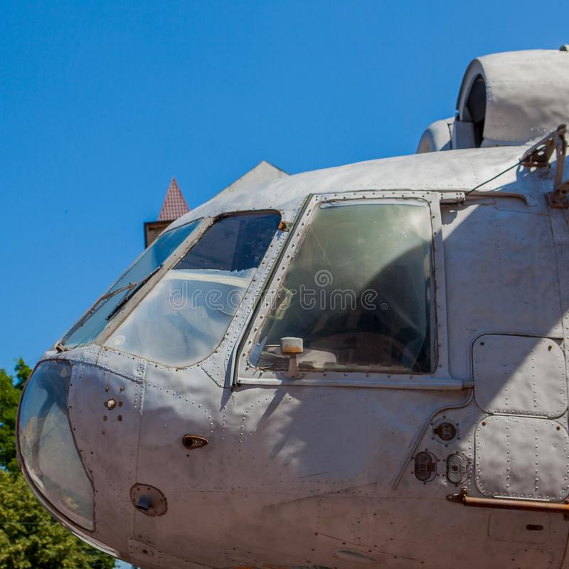 Side view of the helicopter cabin on the background of the sky royalty free stock photo