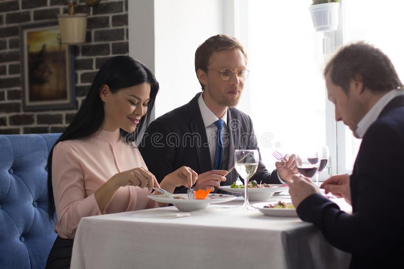 Business people having lunch at luxury restaurant stock images