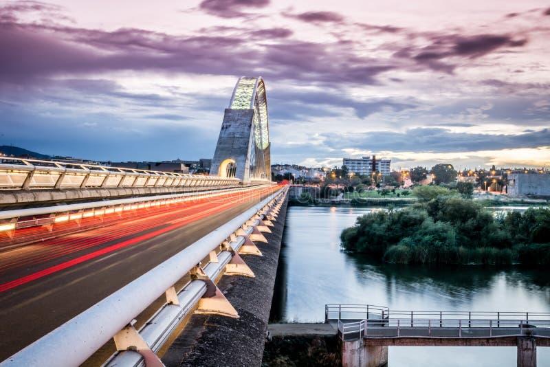 Side view of Lusitania Santiago Calatrava Bridge in Merida Spain.  royalty free stock images